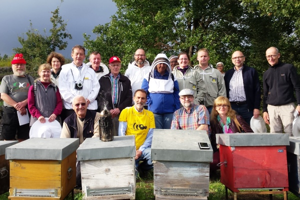Group of beekeepers visiting a local beekeper in Zafferana