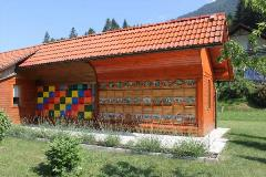 Slovenian bee house with painted front panels
